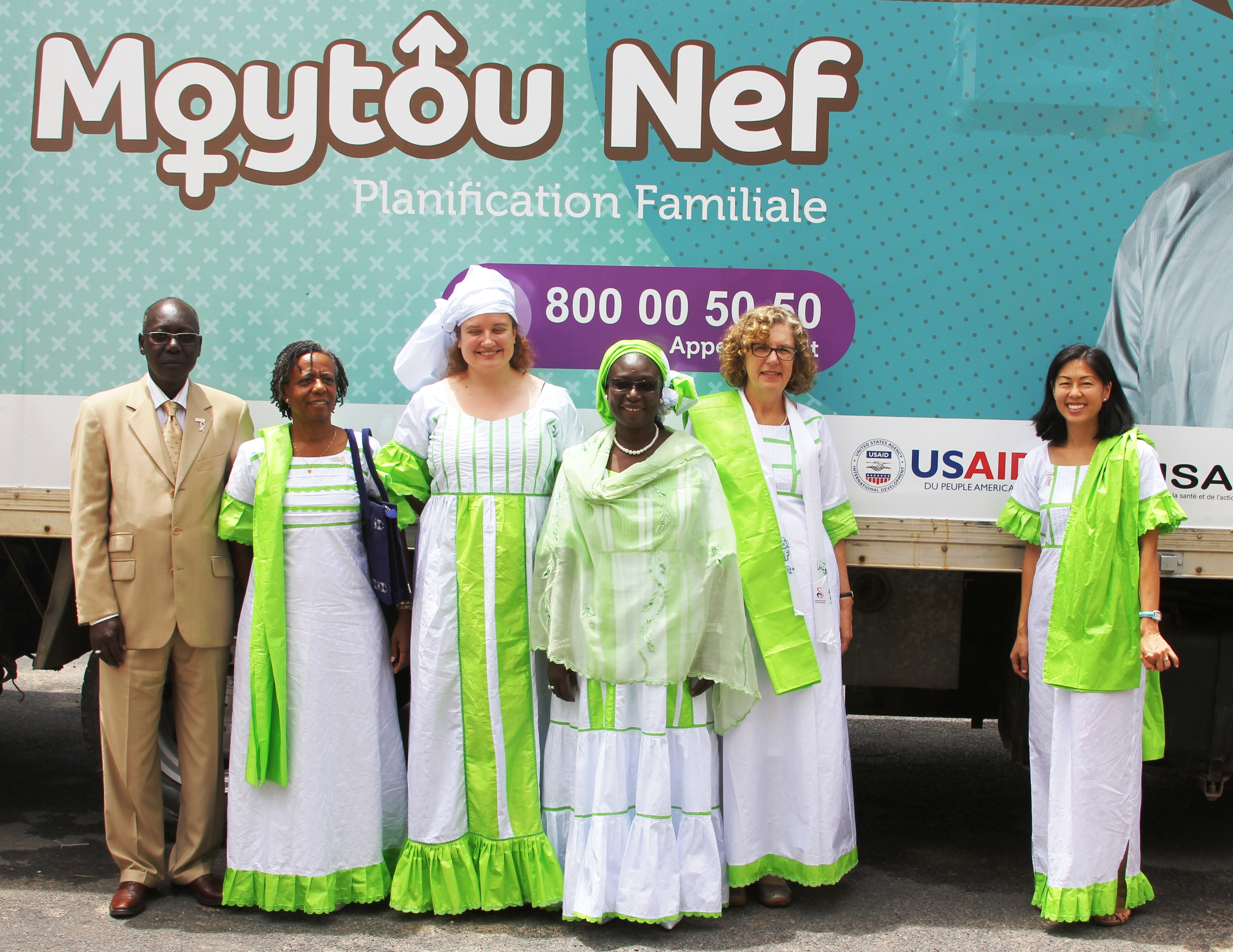 Ms. Clark is shown here in front of a new family planning mobile clinic with USAID Acting Mission Director Alfreda Brewer