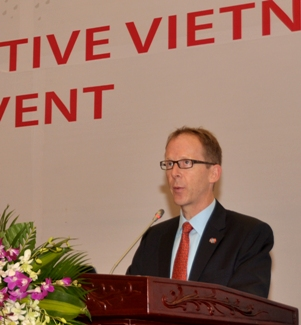 USAID Mission Director Joakim Parker addresses the workshop in Hanoi.