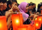 Indonesian youth hold lanterns during a candle-light vigil to mark World AIDS Day in Jakarta Dec. 1, 2009. More than 30 million