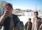 An Afghan youth uses his mobile phone to take pictures in Musa Qala, Jan. 18, 2011.