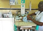 A newborn with respiratory distress at Queen Elizabeth Central Hospital in Blantyre, Malawi, breathes easier with the help of th
