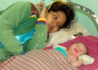 A mother with her newborn at a health center for post-partum care.