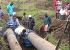 Workers fuse pipes together in Goma.