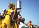 USAID foodstuffs are distributed through the World Food Program to internally displaced persons in Muhadjeria, Darfur.