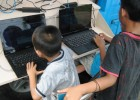 Kids access the Internet in rural West Sumatra.