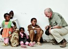 Anthony Lake converses with a family outside a health center in Ethiopia in June 2009, before taking up his post with UNICEF, as