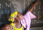 A volunteer provides literacy training to Malian youth.