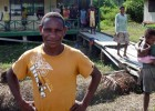 A volunteer teacher in front of the recently built Kokamu Parallel School in Dekai, Yahukimo District, Papua.