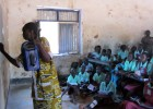 A teacher at Torit East Primary School in Torit, Eastern Equatoria state, South Sudan, holds a solar-powered, wind-up radio as s