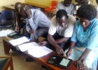 A Yumbe survey team learns how to use electronic tablets to collect data on trachoma.