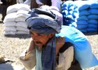 A local farmer picks up his supply of seed and fertilizer as part of a voucher distribution activity at Badam Bagh Farm in Kabul