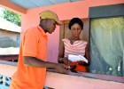 Rosette Joseph processes a customer's electricity bill in Caracol, Haiti, in May 2013.