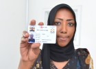 Naima, Mombasa's first medically assisted therapy (MAT) patient, shows her MAT ID card.
