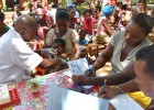 Left to right: district immunization coordinator Gina Biteny, community health volunteer Jeno, and Dr. Jimi Rakotoarimanana provide immunizations in the Analalava district of Madagascar.