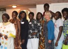 Christie Vilsack, USAID senior adviser for international education, in blue cardigan, with South Sudanese students in USAID-supp