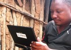 A USAID-trained enumerator uses a tablet to collect information for a Feed the Future baseline survey.