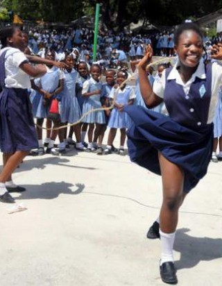 Schoolchildren jump rope at Ecole Marie Dominique Mazzarello in Port-au-Prince on June 18, 2010.