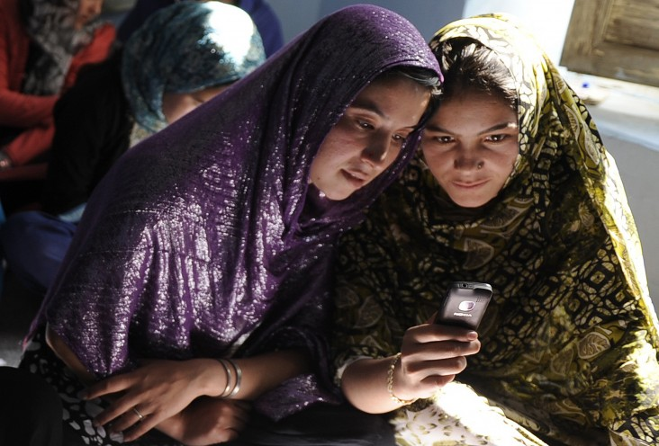 Afghan women sit in a class and study using mobile phones in Kabul. Jawad Jalali/AFP