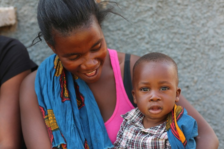 A mother and son attend a USAID handover ceremony in Kabwe.