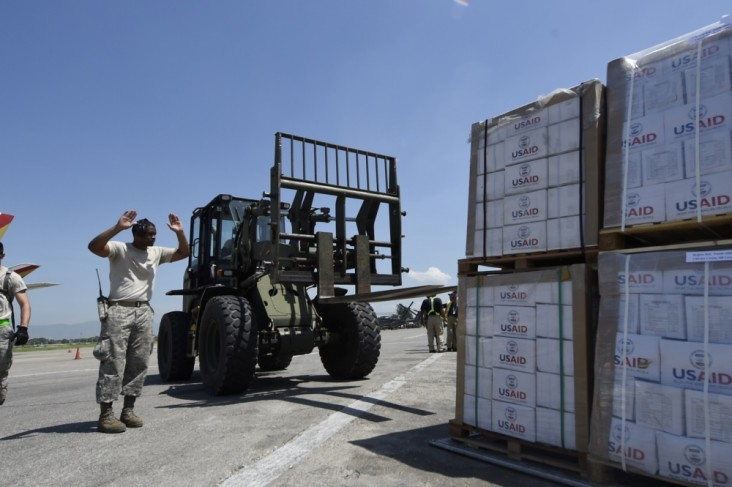 Tech. Sgt. Ronald Rowe, 621st Contingency Response Wing, facilitates transport of USAID food and provisions.
