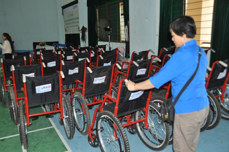 Woman organizing 30 wheelchairs for distribution in Danang, Vietnam