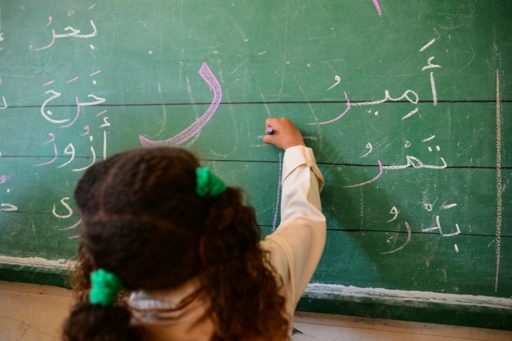 A girl puts her knowledge to the test during an in-class exercise