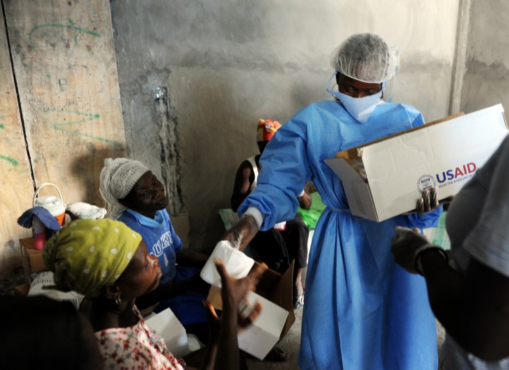 Personnel distribute USAID hygiene kits at a Cholera Treatment Center
