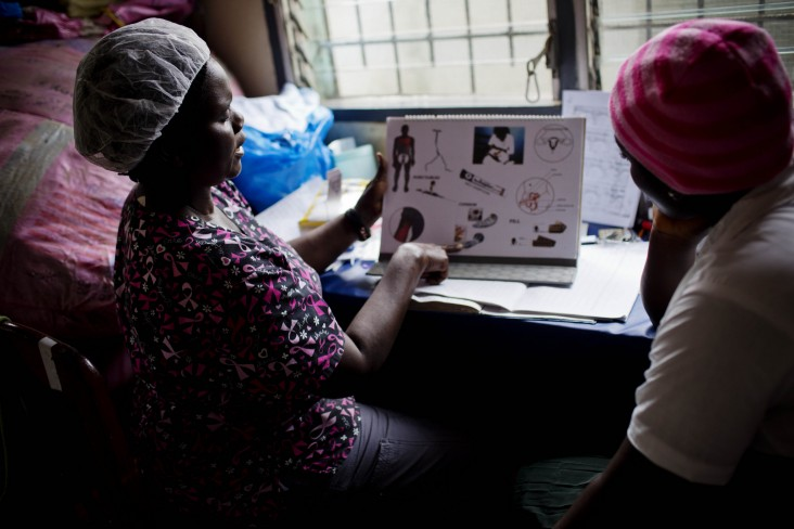 A midwife examining a patient in Liberia