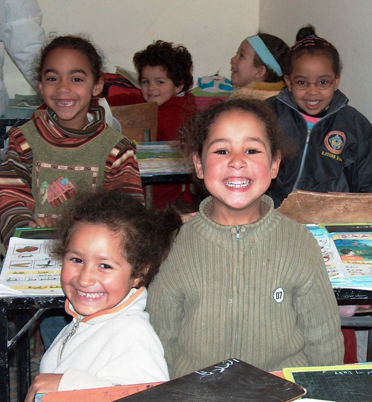 Students learning how to read in a classroom in rural Morocco