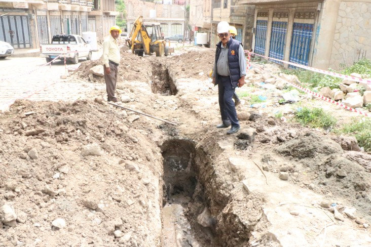 Excavating sewage lines for rehabilitation.