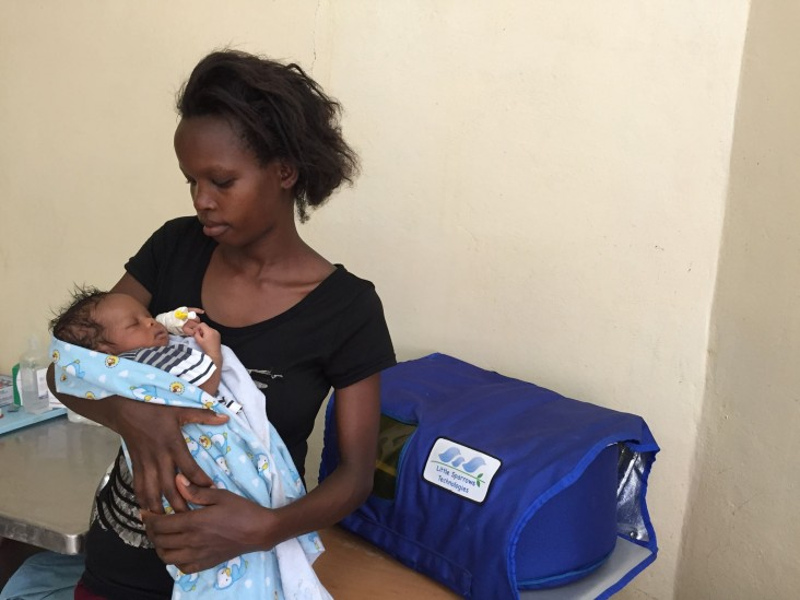 A mother in her Burundi holding her newborn after treatment. Her baby arrived at the hospital at three days of age with critically high Bilirubin levels
