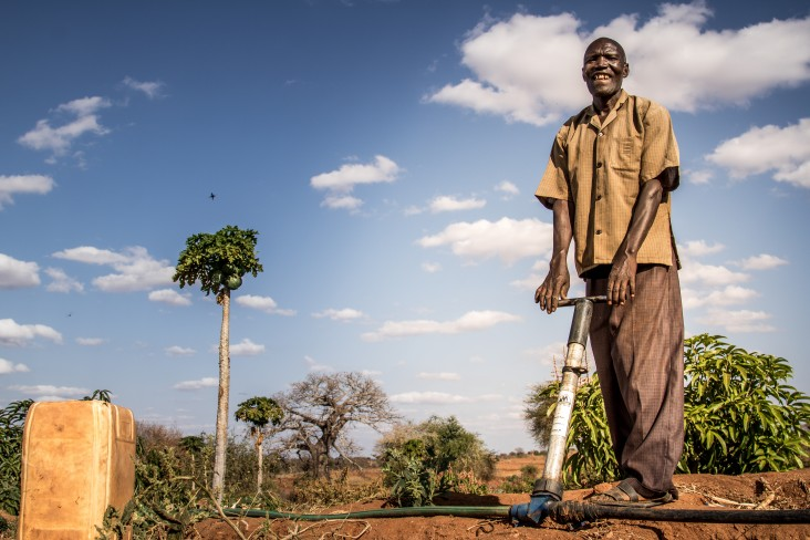 Dominic and his wife have transformed their arid land in Makueni County into viable productive farmland using water-harvesting technology they learned from training supported by USAID and the World Food Program (WFP).