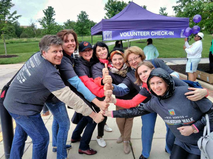 A Community Connections exchange group at a volunteering event during their trip to the United States