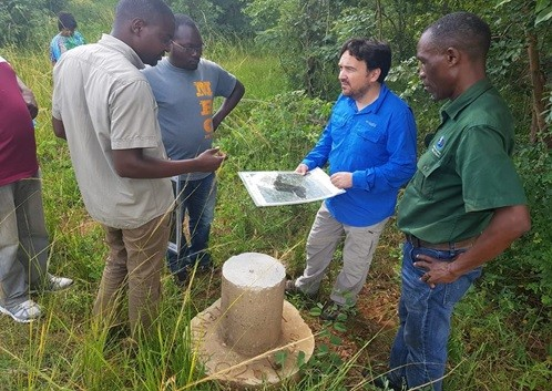 Photo: Environmental Division Team Leader, David Arnoldo Mijan (center), leads USAID's Monitoring and Evaluation (M&E) team during a site visit of protected areas in Lutembwe Forest in Chipata.