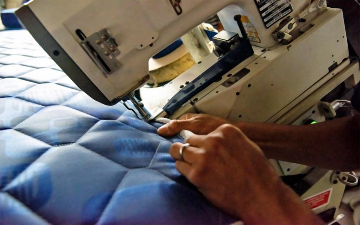 Hands operating a sewing machine