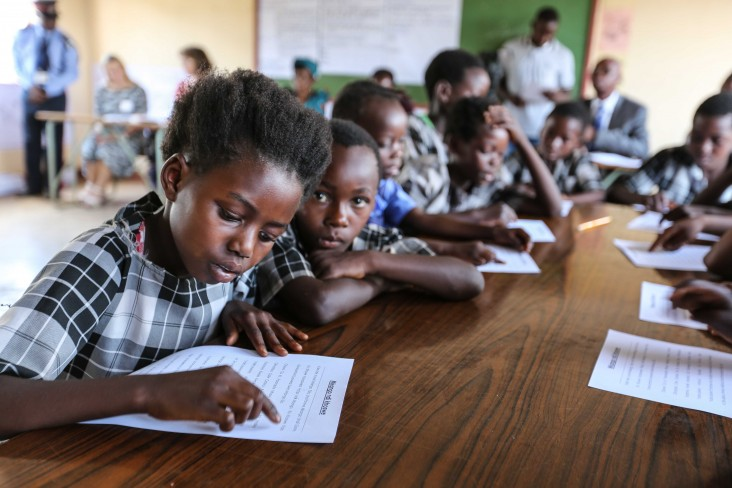 A young learner practices her reading as part of the USAID Let's Read Project at Kasupe Primary School in Chipata.