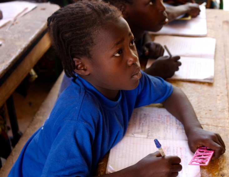 A young girl learning to read in Dosso region, Niger
