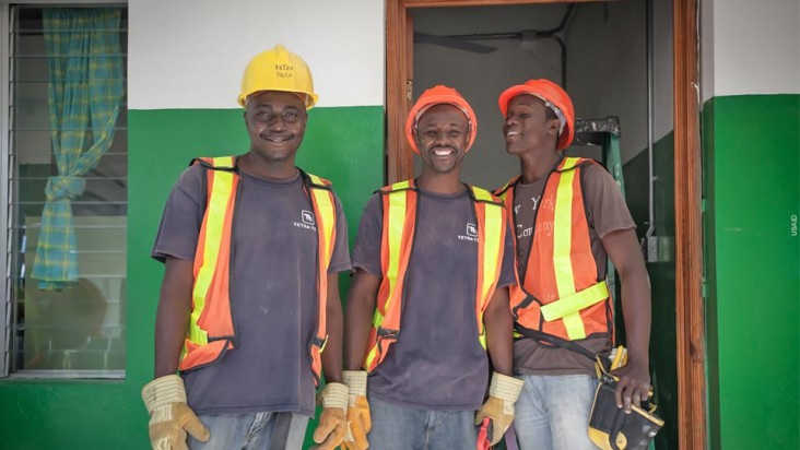 Three men wearing safety gear