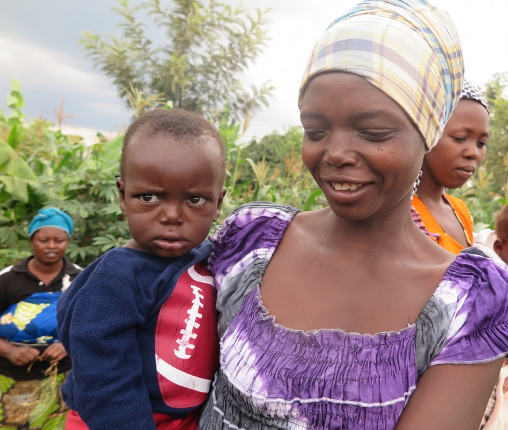Nyirahabimana, a rural mother in Rwanda, holds her son Emmanuel