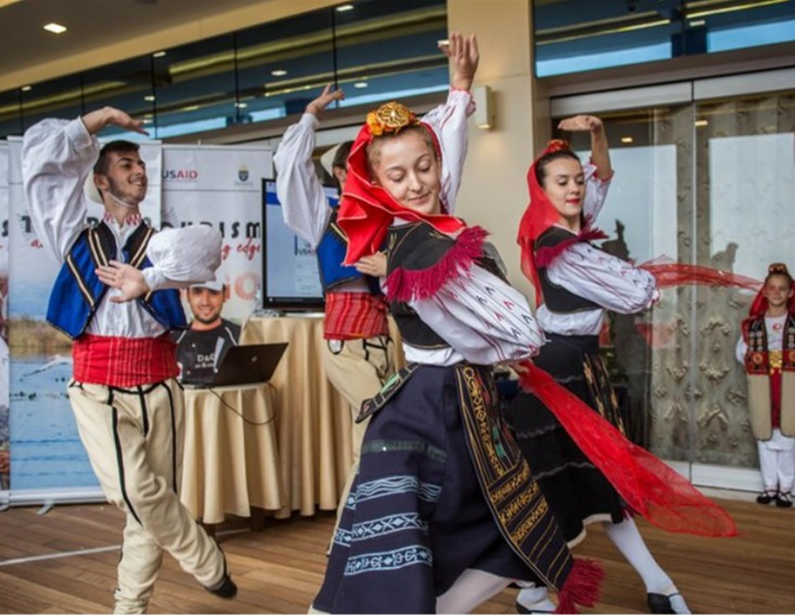 Traditional Albanian dancing troupe performing at a tourism development event.