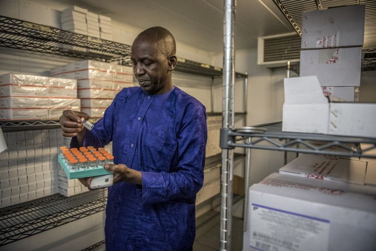 In Bauchi, Nigeria, Muhammed Smi Abdallali, Deputy State Cold Chain Officer, is looking at polio vaccines.