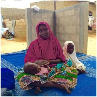 Aisha Suleiman sits with her two children during a USAID-supported nutrition activity in Maiduguri, Nigeria.