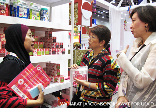 Three women speak to each other in a store