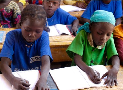 Young girls study their lessons in school. Only 44% of primary school girls will reach sixth grade.