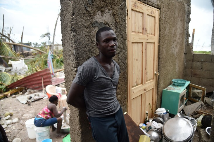 Stanley stands in his destroyed house after the passing of Hurricane Matthew, in Croix Marche-a-Terre, in Southwest Haiti