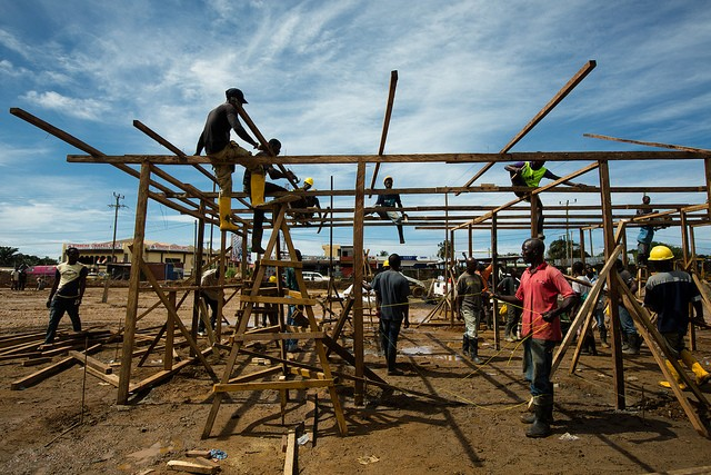 Construction crews work quickly to build a new Ebola Treatment Unit for a growing number of patients