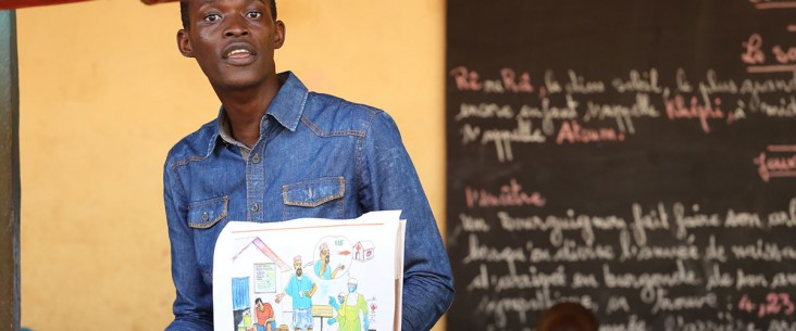 Mohamed Camara a teacher at Le Salem School talks to students about Ebola safety and prevention, in Conakry, Guinea
