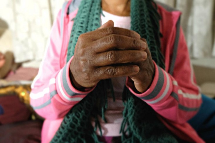 A close-up photo of clasped hands. USAID works with partners around the globe to provide HIV/AIDS care and treatment that is free from stigma and discrimination.