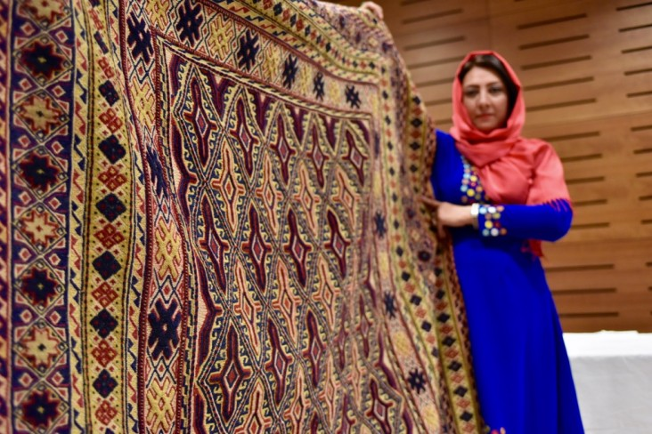 An Afghan businesswomen showcase her products at a fair in Kabul.