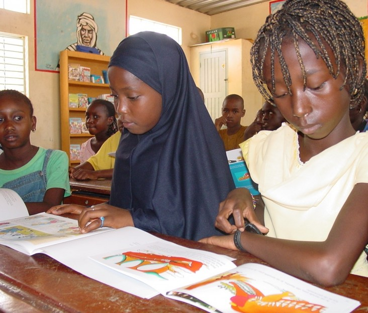 Two female students reading textbooks in a Senegalese school